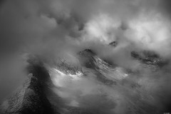 Shrouded in clouds (Rico the noob) Tags: 2018 rock d850 landscape nature outlook switzerland outdoor 2470mmf28 rocks published blackandwhite dof bw mountains monochrome schweiz 2470mm snow ice sky fog clouds stones mountain