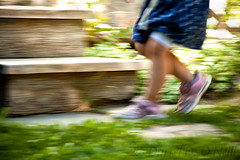 Little Feet on Garden Paths 18 (LongInt57) Tags: motion blur panning running playing fun girl child children person people garden yard outdoor path stairs lawn grass legs blue green brown pink kelowna bc canada okanagan