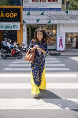 Young Vietnamese woman in Ao Dai crossing street (Apricot Cafe) Tags: img105541 aodai asia asianandindianethnicities canonef2470mmf28liiusm hochiminhcity millennialgeneration vietnam vietnameseethnicity vietnameseculture bottle capitalcities carefree city citylife colorimage crossing cultures day fulllength hairtoss