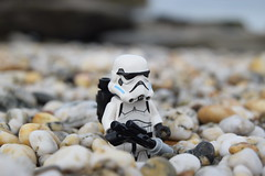 Stormtrooper Outcast. (Working hard for high quality.) Tags: rock pebble planet lego star wars minifigure toy story galactic empire soldier stormtrooper beach seaside