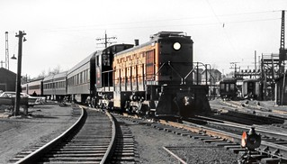 New Haven Railroad DEY-3 class ALCO S-1 switcher # 0990 is seen while switching heavyweight passenger cars in yard area, ca late 1950's