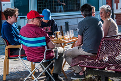 2018 - Belgium - Gent - Street People - 1 of 6 (Ted's photos - For Me & You) Tags: 2018 belgium cropped ghent nikon nikond750 nikonfx tedmcgrath tedsphotos vignetting group groupphoto people seating seats seated sitting glasses chairs table tablesetting ballcap red redrule wineglasses winebottle beerbottle