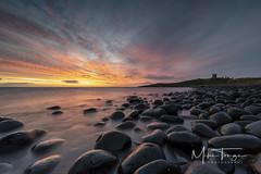 Daybreak at Dunstanburgh. (miketonge) Tags: dolerite boulders dunstanburgh dunstanburgcastle dawn sunrise sky beauty embleton bay northumbria northumberland