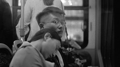 Sleeping on the CTA Bus (Jovan Jimenez) Tags: canon eos rebel t2 ef 50mm f18 stm kodak tmax 3200 bus cta black white gray monochrome monochromatic sleeping people 300x kiss7 film analog analogue public transit glasses street grain streetphotography