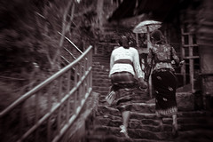 Setting the pace. (Triple_B_Photography) Tags: bali balinese blackwhite blur bokeh asia canon eos 7d 2017 dark filter grain girl hindu indonesia lokal lifestyle leaves lines motion orang people portrait travel tourism traditional tropical world warmth walking climbing staircase streetlife young splittone