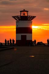 Sunshade (Alex Fonderson) Tags: holland netherlands nederland sunset scheveningen beach breakwater vuurtoren