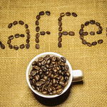 Filled Coffee Cup with Kaffee sign in the Background thumbnail