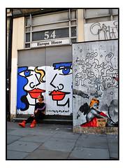 STREET ART by ANNA LAURINI, LORETTO & POTATO NOSE (StockCarPete) Tags: loretto annalaurini streetart londonstreetart urbanart graffiti soho london uk redlips redshoes posing sitting potatonose