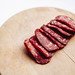 Salami slices on wooden cutting board. Close up