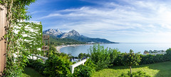 A view from a room (Anthony P.26) Tags: category goynuk hdr panorama pharselishillresort places seascape travel turkey sea water sky whiteclouds bay mountains taurusmountains canon550d canon1855mm canon outdoor beach trees bushes garden grass lawn fence