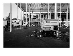 161015_b_00011_OM2n-ilford-delta-400_antwerpen_theaterplein 6/8 (A Is To B As B Is To C) Tags: aistobasbistoc b belgië belgium antwerpen antwerp theaterplein vogelenmarkt olympus om2n analog film ilford delta 400asa bw blackwhite blackandwhite monochrome vishandel vis romaincostermans markt market cleaning dirt afval architecture secchivigano canopy columns urban urbanrenewal urbanism city cityscape citylife evita fall evening light