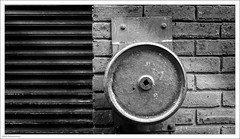 Shutter Control 259/365 (John Penberthy ARPS) Tags: 365the2018edition shutter d750 nikon monochrome 16sep18 3652018 day259365 door bricks mono handle blackandwhite wheel johnpenberthy