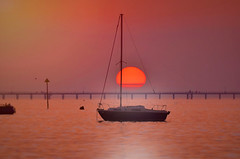 Sundown... (KissThePixel) Tags: sunset sunsets yacht yachtlife sea ocean boat reflection pinksky redsky sky sun sunball ballofsun orangesun redsun seascape skyscape southend southendonsea estuary thamesestuary riverthames night evening sundown nikon peace peaceful