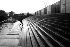 Hurrying (pascalcolin1) Tags: paris13 bnf homme man pluie rain reflets reflection marches photoderue streetview urbanarte noiretblanc blackandwhite photopascalcolin 50mm canon50mm canon