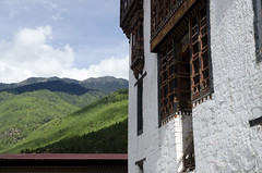 Tashichho Dzong and Green Mountains (William J H Leonard) Tags: thimphu bhutan bhutanese southasia southasian summer sunny travel travelphotography travelling tashichhodzong buddhist buddhism buddhisttemple architecture asianarchitecture wall building