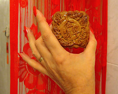 It's a mooncake.... yes, that time of the year! :) (ShambLady in Throwback times, uploading older pics) Tags: mooncake lantern festival mid autumn midautumn cookies tradition sweet savory savoury egg yolk bean paste red lotus seed hand rojo rouge nails unas fingers ring dedos curtain chinese folkloric moon luna chino malaysia 2013 160913 penang hands handen main mano manos mains มือ கை 손 手 கைகள் יד हाथ ಕೈ دست mão האַנט рука చేతి страна hände χέρι tangan