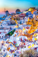 Traveling Concepts. Panoramic View of Famous Old Town of Oia or Ia at Santorini Island in Greece. Taken During Blue Hour with Traditional White Houses and Windmills. (DmitryMorgan) Tags: landscape aegean architecture aurora bluehour building caldera church cityscape destination dusk europe european famous greece greek hellenic historic holiday island iya landmark mediterranean mountain oia oya panoramic picturesque resort rock romantic santorini scenery sky slope summer summit sunlight sunny thera tourism town traditional traveling twilight view village volcano windmill