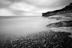 Tiny Cliff (zdenisaba) Tags: cliff water sky clouds island sea monochrome kos beach horizont stone rocks secluded