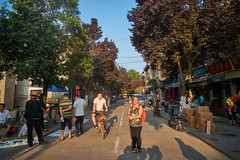 2018 Xi'an - Street Scenes 06 (C & R Driver-Burgess) Tags: street pavement footpath walking city ancient historical scholarsstreet stationers xian 西安 woman red backpack smile man cycle bicycle pedestrian