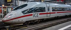 2018 - Germany - Munich Hauptbahnhof (Ted's photos - For Me & You) Tags: 2018 cropped germany munich nikon nikond750 nikonfx tedmcgrath tedsphotos vignetting münchenhauptbahnhof munichcentraltrainstation db bbrail ice icetrain intercitytrain wideangle widescreen train trainstation traintracks red redrule reflection