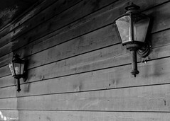 Outdoor Sconces (that_damn_duck) Tags: nikon blackwhite monochrome lighting sconces outdoorlamps woodsiding lightbulbs bw blackandwhite