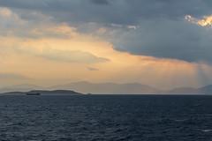 Aegean sunrise (Adrià Páez) Tags: aegean sunrise water mediterranean sea greece ellada attica europe 50mm sky clouds light mountains boat sunlight canon eos 7d mark ii