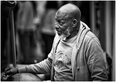 """Everyone lives by selling something."" - Robert Louis Stevenson (gro57074@bigpond.net.au) Tags: listening streetvendor 70200mmf28 nikor nikon monotone monochrome mono bw blackwhite gentle sydney 2018chatswoodstreetfair chatswood candidportrait portrait candid"