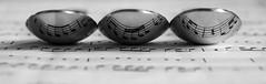 Musical spoons (Emily S Brown) Tags: metal metallic spoon spoons cutlery music musical notes reflection mirror macro trio home canon indoors closeup black white blackandwhite mono monochrome shadows noir macromondays