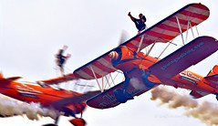 High kicks for high flyers... (Ian A Photography) Tags: aeroplanes aircraft airfestival airshow aerobatics aerosuperbatics aviation bigginhill acrobatics biplanes boeing boeingstearman nikon planes wingwalkers