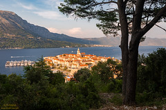Marco Polo's birthplace (Alen Ferina photography) Tags: korcula korčula islandkorcula islandkorčula dalmatia dalmacija croatia hrvatska adriatic mediterranean jadran jadranskomore sea coast water adriaticsea summer day europe europeanunion eu urban channel pelješac peljesac islandpelješac islandpeljesac orebic orebić panorama panoramic trees panoramicview scenic elevated view oldtown historical church belltower markopolo markopolobirthplace architecture roofs skyline port harbour dalmatian croatian flag boats ships yacht traffic waterfront townscape landscapeoriented horizontaloriented landscape