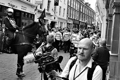 When you find yourself in the middle of an angry demonstartion.   You take a Photo... (WorcesterBarry) Tags: blackwhite bnw blackandwhite buildings places people photographers demonstrations street streetphotography streetphoto travel adventure anger horse police