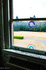 Hippie Window (jenelle.melchior) Tags: decal window vintage antique midcentury sun rainbow paint peeling historical restoration preservation seminary dormitory kenmore