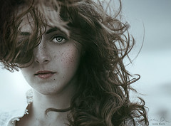 I see through you ({jessica drossin}) Tags: jessicadrossin portrait woman hair wind blowing freckles desaturated curls eyes close up face wwwjessicadrossincom