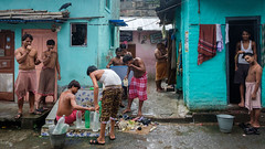 Public bathing (SaumalyaGhosh.com) Tags: bathing public people color colour kolkata india street streetphotography fuji fujifilm xt2 crow comb