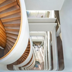 Down towards the Light (Paul Brouns) Tags: archdaily architecture architectuur architektur архитектура ден босс нидерланды netherlands nederland canon staircase lookingdown perspective white modern office light lighting sunny man square paulbrouns paulbrounscom paul brouns