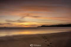 Magical Sunset (Christian Lawrence Photography) Tags: sunset wales beach footsteps glow water ocean sky magical