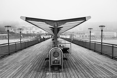 Boscombe Pier in the fog (John French 108) Tags: pier boscombe fog bw bournemouth water sea seaside outdoor architecture infrastructure structure building symmetry landscape beach lines texture pattern dorset mono perspective pathscaminhos