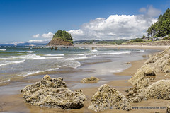 The beach at Neskowin (doveoggi) Tags: 0413 oregon neskowin coast rocks island clouds surf ocean beach