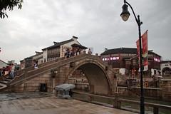 無錫--清明橋水弄堂街區 (沐均青) Tags: chinese travel summer china historical cultural buildings white people cannal water river lantern raining red street arch bridge sky grey starbucks restaurant