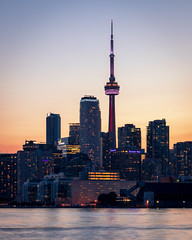 Lights Coming On (Brady Baker) Tags: canada toronto ontario skyline urban cityscape city cntower towers buildings downtown waterfront core harbour harbor harbourfront polson pier sunset dusk lights glow calm outdoor sky