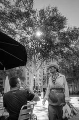 Strangers (Luis Alvarez Marra) Tags: strangers bw monochrome nikon d7000 24mm prime barcelona spain catalonia candid street streettog tog collecting soul decisive moment couple gesture