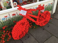 Poppy cycle. (Bennydorm) Tags: pavement august iphone6s inglaterra inghilterra angleterre europe uk gb britain england lancashire morecambe hobbies shop handicrafts poppies decorated red bicycle cycle