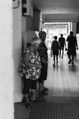 Bukit Permai, Singapore, March 2018. (darcymillervisuals) Tags: bukit permai women bw black white candid street photographer photography singapore 3 figures hdb south sony a6500 sigma 30mm 14 f28 45mm 1125 iso100 fan ho henri cartier bresson