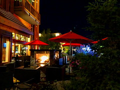 Pacini by night (+2) (peggyhr) Tags: peggyhr umbrellas red fireplace restaurant italian banff patio img6510a iphone alberta canada thelooklevel1red super~sixbronze☆stage1☆ thelooklevel2yellow thegalaxy thegalaxystars
