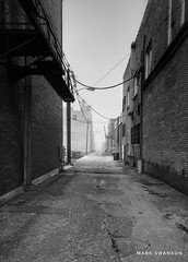 Alley (mswan777) Tags: iphone iphoneography apple mobile gray white black ansel monochrome architecture michigan bentonharbor urban straight parallel brick alley building outdoor cityscape city street