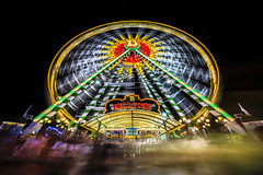 (B) (Blende1.8) Tags: kirmescrange night nightscape nacht nachtaufnahme lichter farben kirmes crange crangerkirmes lights light colors colorful colour colours ferriswheel riesenrad bellevue rotunde kreis movement bewegung longexposure langzeitbelichtung people crowd bewegungsunschärfe wideangle sony ilce7m3 sel1224g 1224mm a7iii a7m3 alpha emount nrw carstenheyer blur ghost geister