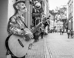 A most pleasant meet with Lubbers infront of the most pleasant shop FotoSipkes.nl (12-08-2018) by #MrOfColorsPhotography #InspireMediaGroningen #PortfolioOfColors #PortraitsOfColors (mrofcolorsphotography) Tags: blackandwhite black blackandwhitephotography blackandwhitephoto blackandwhiteportrait photooftheday photographer photography photo photos city cityphotography cityphotographer portfoliofocolors portfolio portfolioofcolors portrait portraits portretten portret canonnederland canon canonphotography canon80d instagood streetphotography street streetphotographer streets artist music musician gitarist dillenvandermolen portraitsofcolors porttraitsofcolors groningen netherlands thenetherlands holland scene scenery life lifestyle bnw white grey