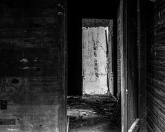 Looking Through the Abandoned House (that_damn_duck) Tags: nikon blackwhite monochrome abandoned urbex urbanexplorer wood decaying debris bw blackandwhite