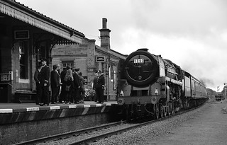 Locomotive No.70013 'Oliver Cromwell' rolls into Quorn & Woodhouse Station, with a re enactment of  1T57, the 15 Guinea Special, that was the last British Railways steam hauled passenger train. Great Central Railway. 12 08 2018