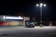 Squamish (Curtis Gregory Perry) Tags: squamish british columbia night long exposure parking lot light smoke store mural wall sign nikon d810 dodge ram 1500 streetlight lamp streetlamp planter plants landscaping canada canadian